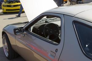 Silver Porsche receiving regular maintenance